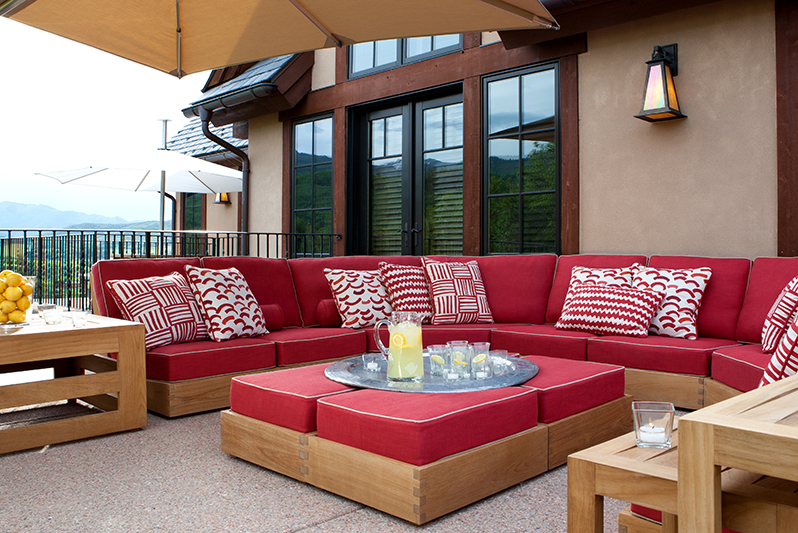 Patio in Aspen Colorado on Buttermilk Mountain with Perennials outdoor fabric and David Sutherland Teak Furniture.